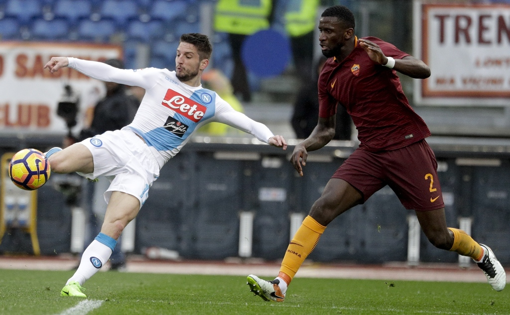Napoli's Dries Mertens, left, kicks the ball past Roma's Antonio Rudiger during a Serie A soccer match between Roma and Napoli, at the ...