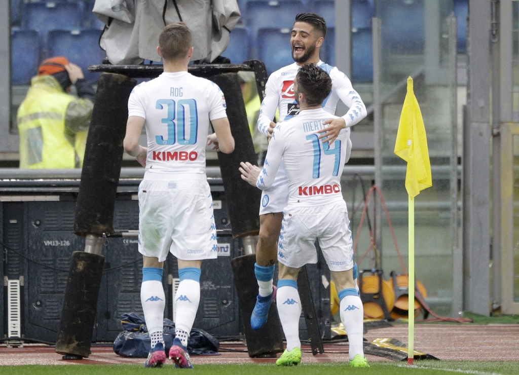 Napoli's Dries Mertens, right, back to camera, celebrates with his teammate Lorenzo Insigne and Marko Rog, left, after scoring during a...