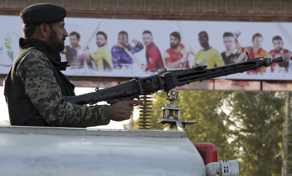 Pakistani paramilitary soldier stands alert on a vehicle while monitoring area to ensure security at an entry gate of Gaddafi stadium f...