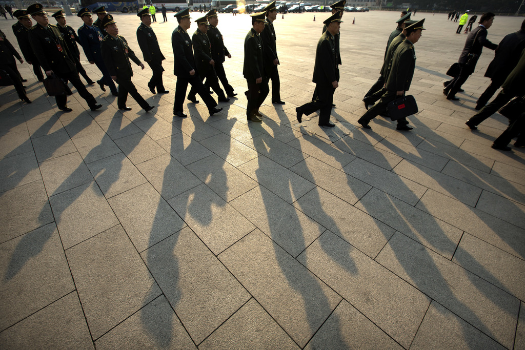 Delegates from China's People's Liberation Army (PLA) arrive at the Great Hall of the People to attend a plenary session of the Nationa...