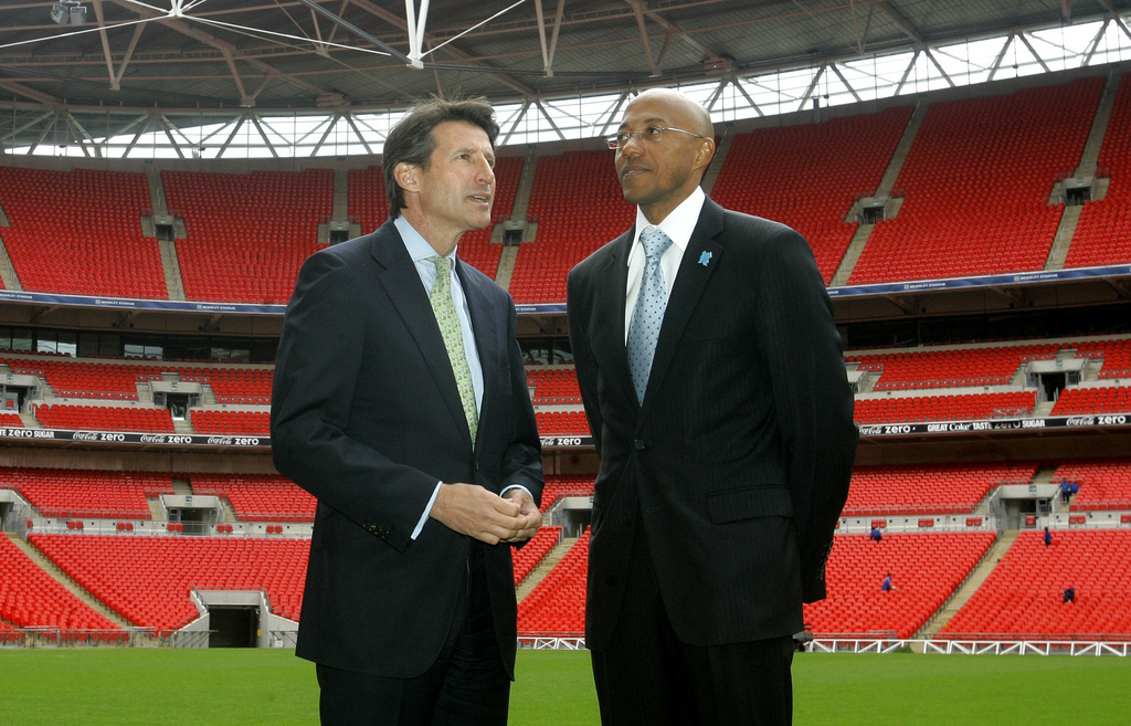 FILE - This is a Tuesday, May 20, 2008  file photo of Namibian former athlete Frank Fredericks, right, as he  takes a look on the Wembl...