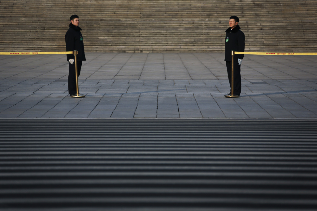 Soldiers dressed as ushers stand in position as they wait for arriving delegates from China's People's Liberation Army (PLA) to attend ...