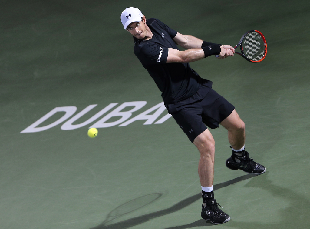 Andy Murray of Great Britain returns the ball to Fernando Verdasco of Spain during the final match of the Dubai Tennis Championships, i...
