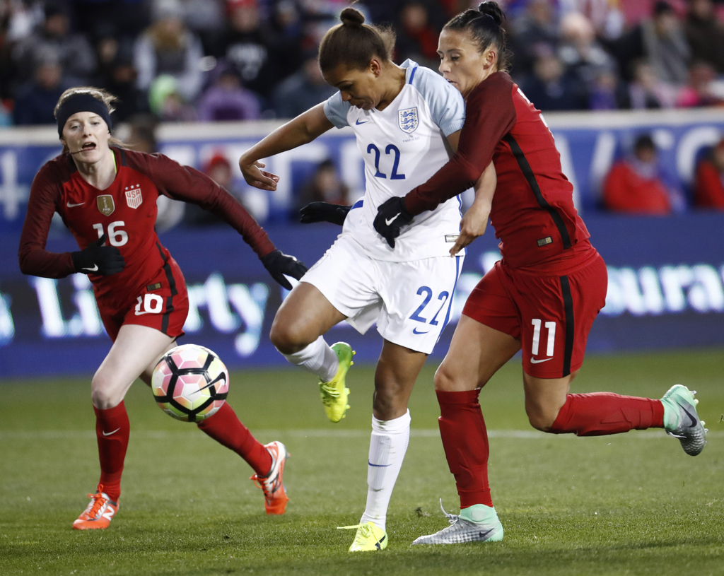 England forward Nikita Parris (22) rushes toward the net as United States defender Ali Krieger (11) closes in during the first half of ...