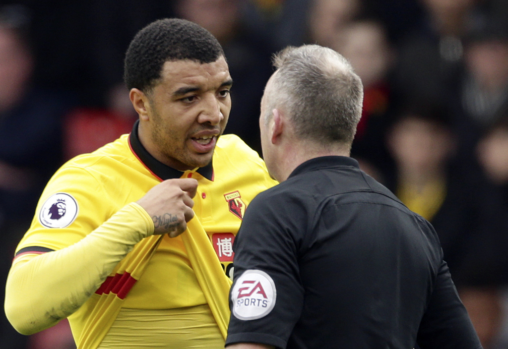 Watford's Troy Deeney, LEFT, talks to referee Jonathan Moss about shirt pulling, during the English Premier League soccer match between...