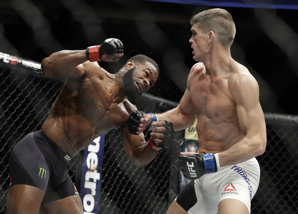 Tyron Woodley, left, fights Stephen Thompson in a welterweight championship mixed martial arts bout at UFC 209, Saturday, March 4, 2017...