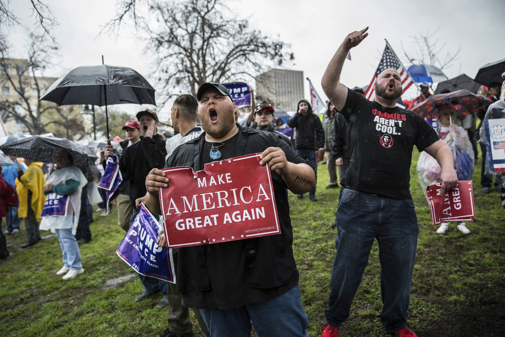 """Supporters of President Donald Trump react to counter-protesters during a """"March 4 Trump"""" rally, one of several such events held in cit..."""