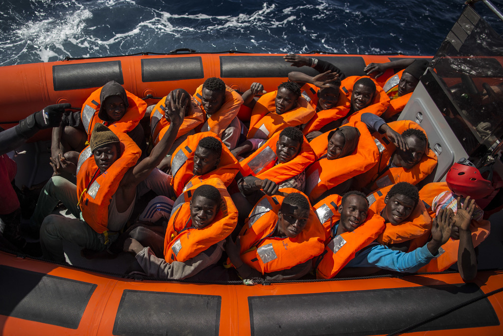 A rescue team of the Spanish NGO Proactiva Open Arms transfers refugees and migrants, from different African countries, from the overcr...