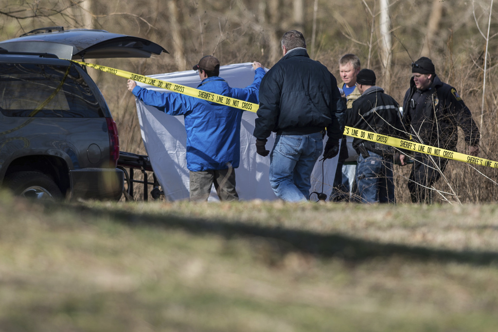 Police remove the body of Jacqueline Watts from the scene where her body was found on a sandbar in the Flatrock River near Noblitt Park...