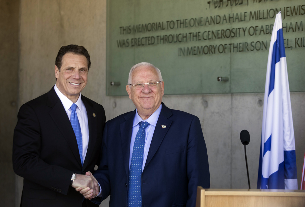 The Governor of New York Andrew M. Cuomo, left, and Israeli President Reuven Rivlin shake hands at the Yad Vashem Holocaust memorial, i...
