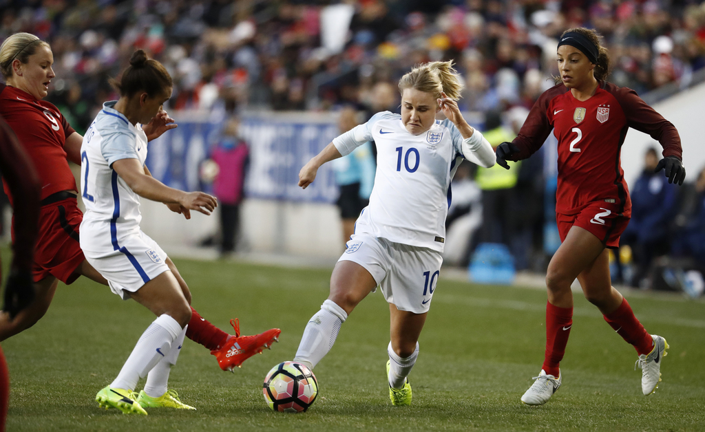 England midfielder Izzy Christiansen (10) and teammate forward Nikita Parris, second from left, compete against United States midfielde...