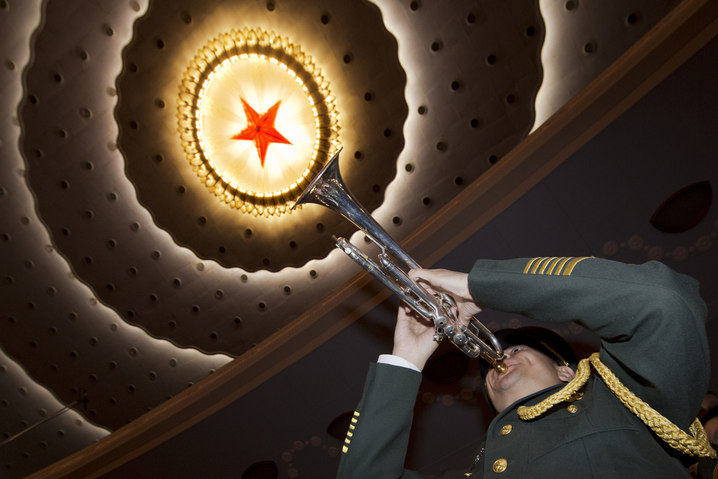 A member of a Chinese military band rehearses before the opening session of the annual National People's Congress at Beijing's Great Ha...