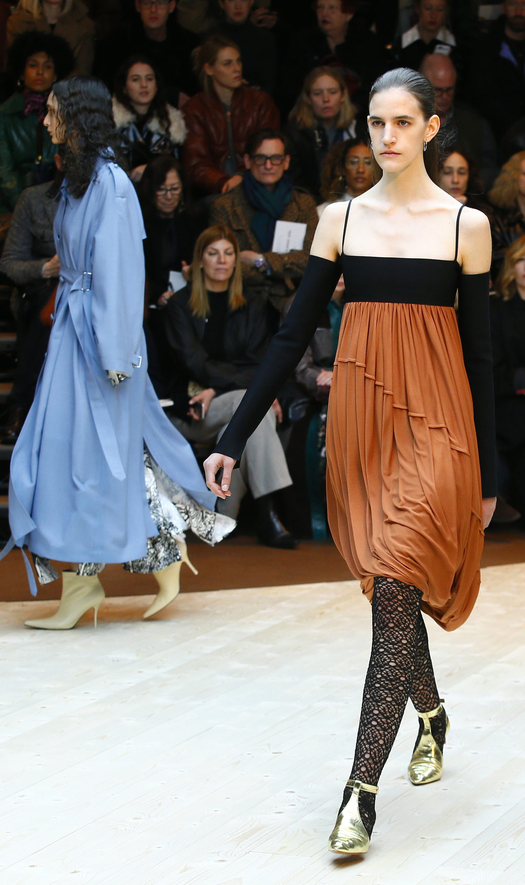 A model wears a creation for Celine's Fall-Winter 2017/2018 ready-to-wear fashion collection presented Sunday, March 5, 2017 in Paris. ...