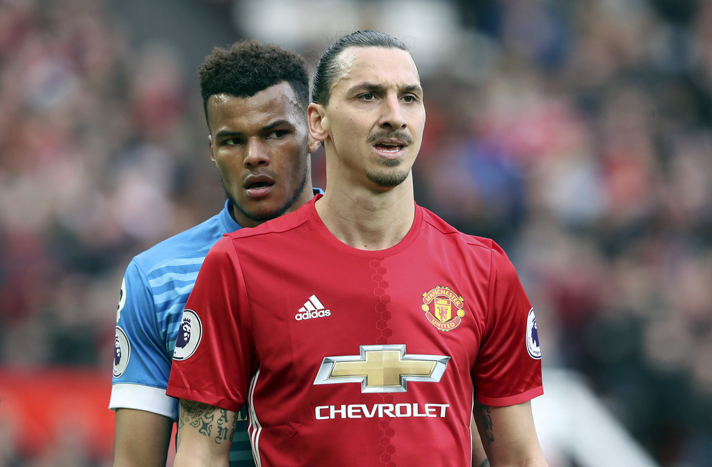 AFC Bournemouth's Tyrone Mings, left, and Manchester United's Zlatan Ibrahimovic during the English Premier League soccer match at Old ...