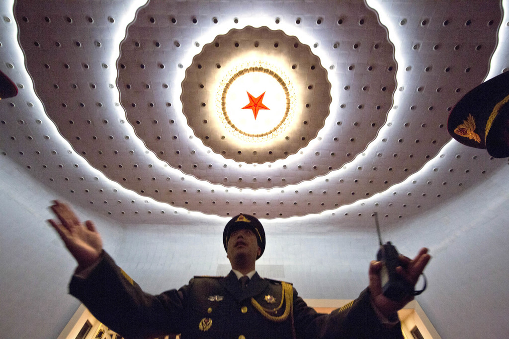 A Chinese military band conductor rehearses before the opening session of the annual National People's Congress at Beijing's Great Hall...