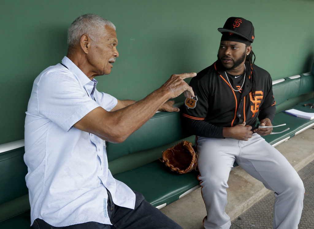 San Francisco Giants starting pitcher Johnny Cueto, right, talks to former manager Felipe Alou before a spring trianing baseball game i...