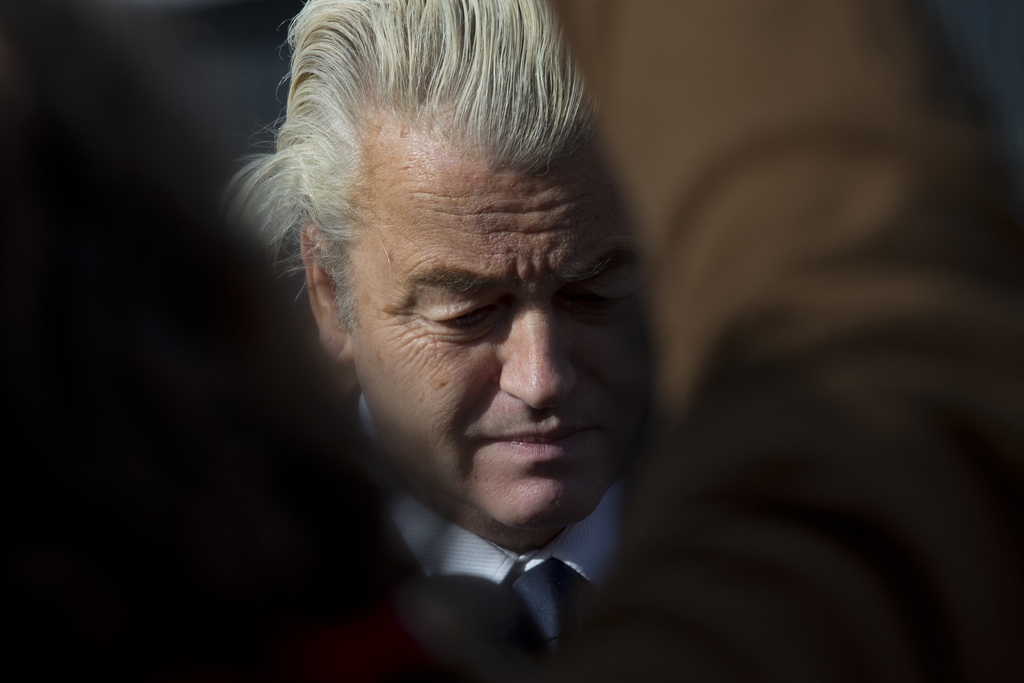 Firebrand anti Islam lawmaker Geert Wilders answers question from the media during an election campaign stop outside De Telegraaf newsp...