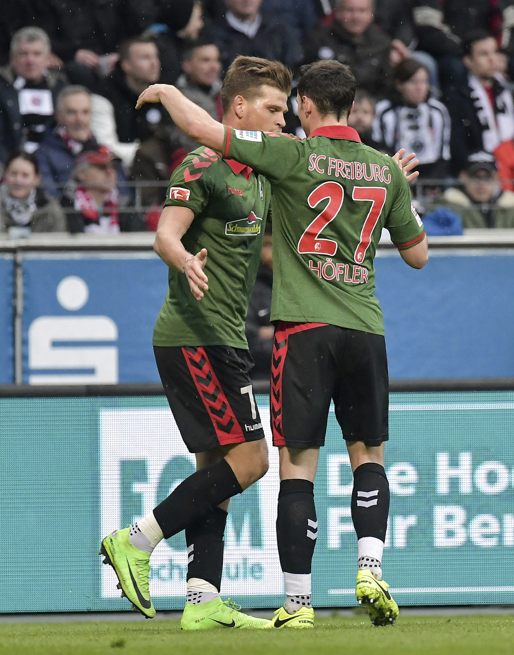 Freiburg's Florian Niederlechner,  left, celebrates his goal with Nicolas Hoefler, right, during the Bundesliga soccer match between Ei...