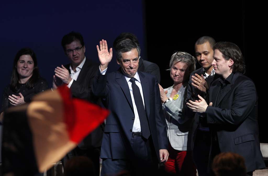 Conservative presidential candidate Francois Fillon waves as he arrives to deliver his speech during a campaign meeting in Aubervillier...