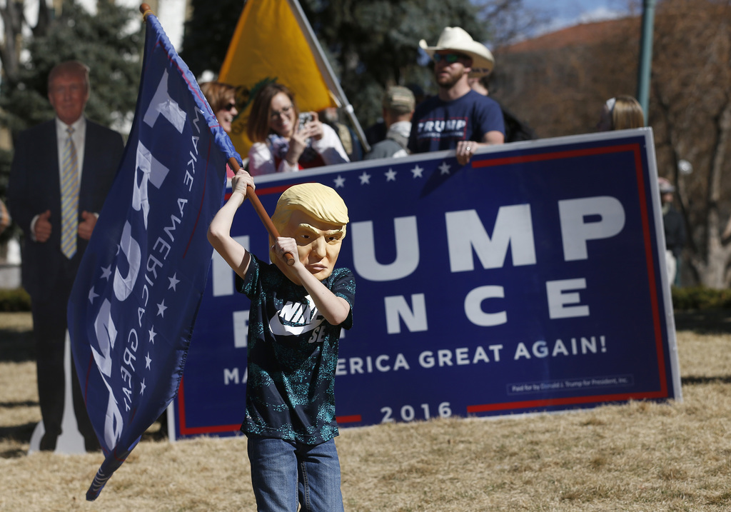 Supporters of President Donald Trump gather during a March 4 Trump rally at the state capitol in Denver, Saturday, March 4, 2017. (AP P...