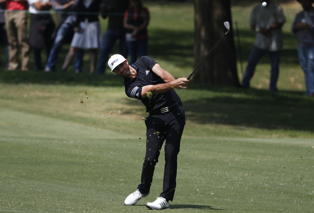 Dustin Johnson of the U.S. hits a ball on the 1st hole in round three of the Mexico Championship at Chapultepec Golf Club in Mexico Cit...