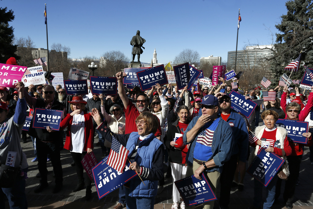 Supporters of President Donald Trump gather during a March 4 Trump rally on the state Capitol steps in Denver, Saturday, March 4, 2017....