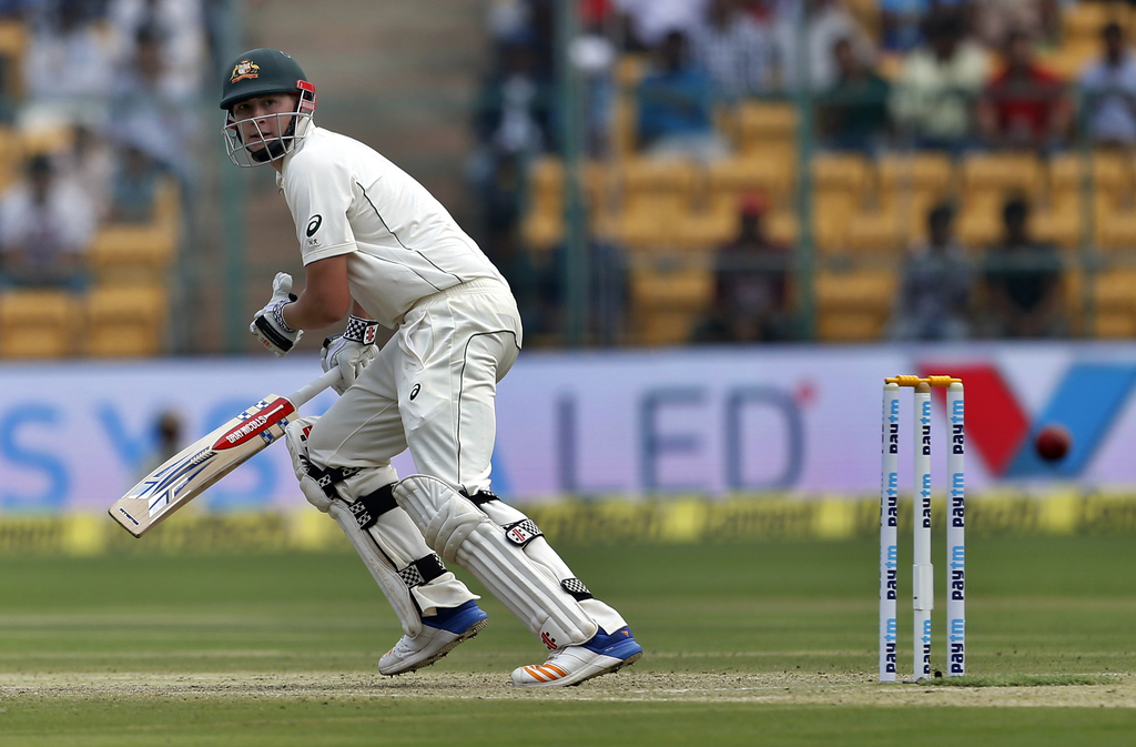 Australia's Matt Renshaw watches his shot during the second day of their second test cricket match against India in Bangalore, India, S...