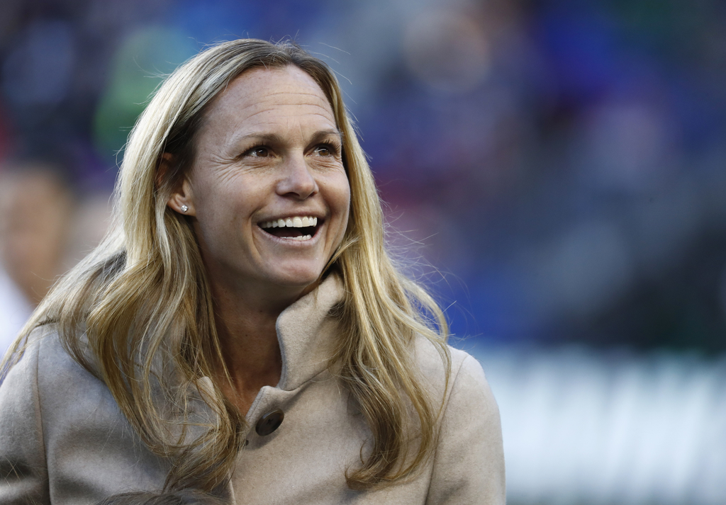 Former United States women's soccer player Christie Rampone reacts during a ceremony honoring her prior to a SheBelieves Cup women's so...