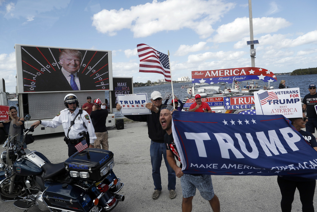 Supporters of President Donald Trump gather outside Mar-a-Lago, Saturday, March 4, 2017, in Palm Beach, Fla. (AP Photo/Alex Brandon)   ...