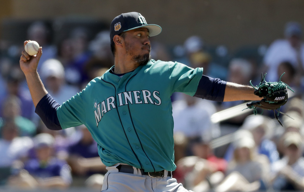 Seattle Mariners starting pitcher Yovani Gallardo throws against the Seattle Mariners during first inning at a spring baseball game in ...