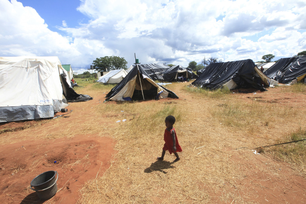 A child walks at a camp set up for flood victims in Tsholostho about 200 kilometres north of Bulawayo, Saturday, March 4, 2017. Zimbabw...