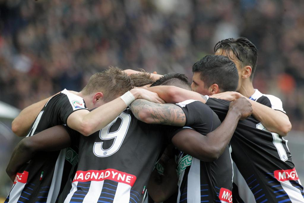 Udinese's Duvan Zapata, center, celebrates with teammates after scoring during a Serie A soccer match between Udinese and Juventus, at ...