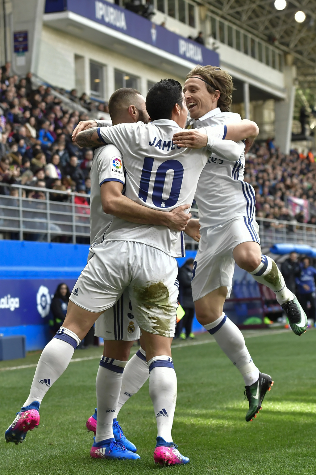 Real Madrid's James Rodriguez, celebrates after scoring his team's third goal of the game with teammates Luka Modric and Karim Benzema,...