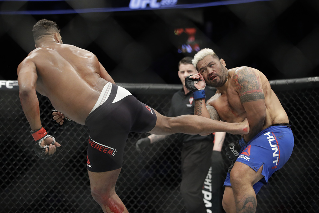 Alistair Overeem kicks Mark Hunt during a heavyweight mixed martial arts bout at UFC 209, Saturday, March 4, 2017, in Las Vegas. (AP Ph...