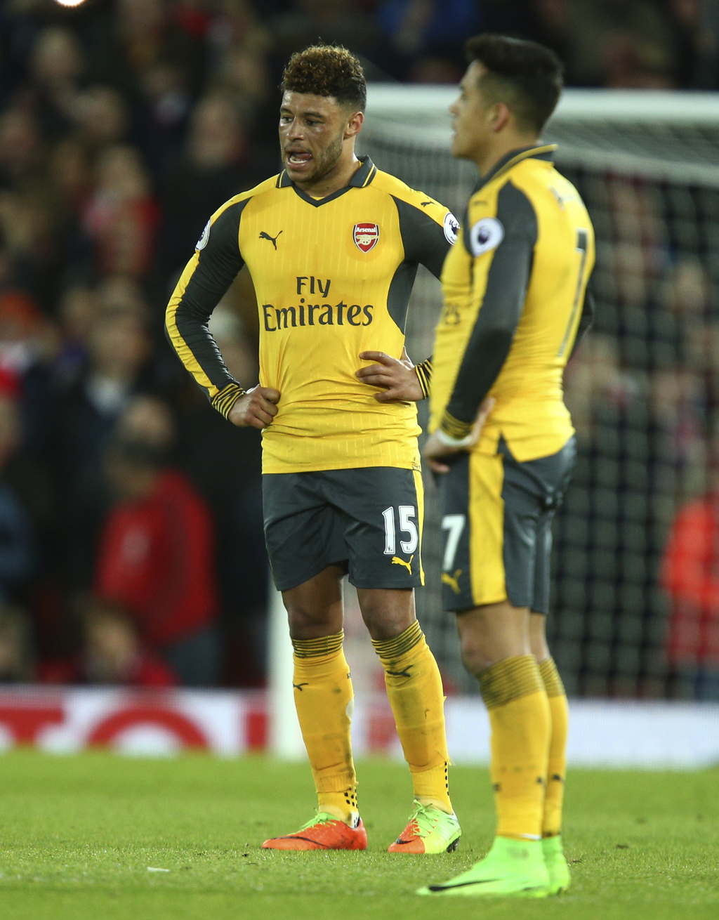 Arsenal's Alex Oxlade-Chamberlain and teammate Arsenal's Alexis Sanchez stand on the pitch after the end of he English Premier League s...