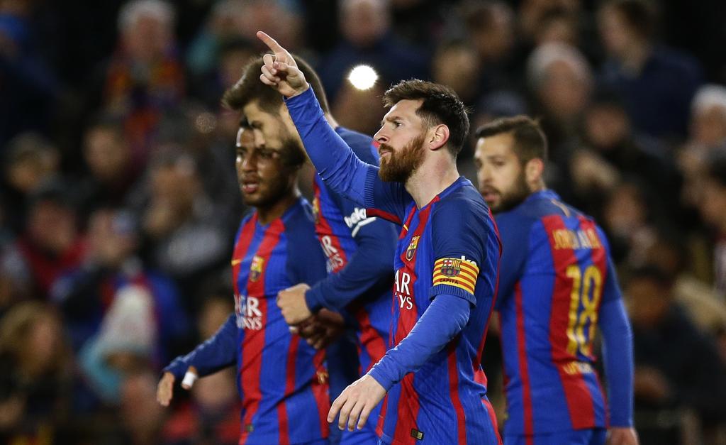 FC Barcelona's Lionel Messi gestures after scoring during the Spanish La Liga soccer match between FC Barcelona and Celta Vigo at the C...