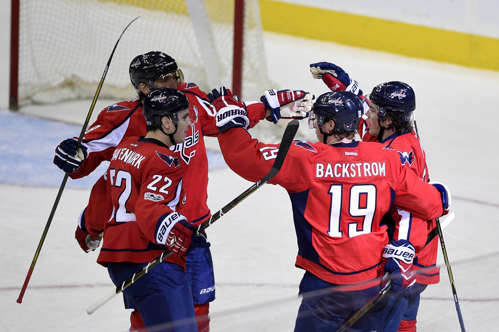 Washington Capitals center Nicklas Backstrom (19), of Sweden, celebrates his game winning goal during the overtime period of an NHL hoc...