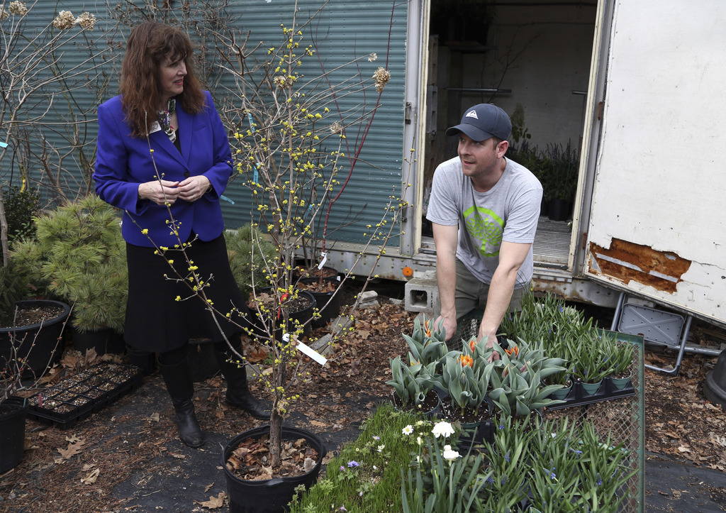 In this Wednesday, March 1, 2017, photo, Jenny Rose Carey, senior director of PHS Meadowbrook Farm, left, and head grower Nathan Roehri...