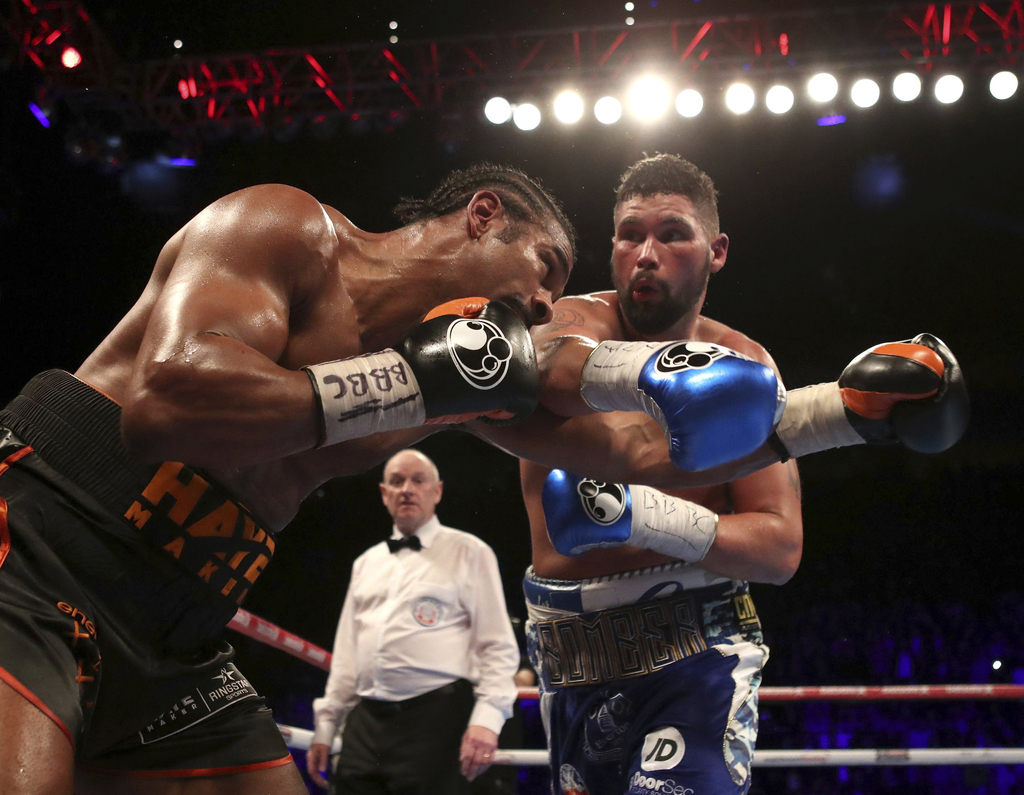 Britain's Tony Bellew, right, and his countryman David Haye exchange their punches during their heavyweight contest at the O2 Arena in ...