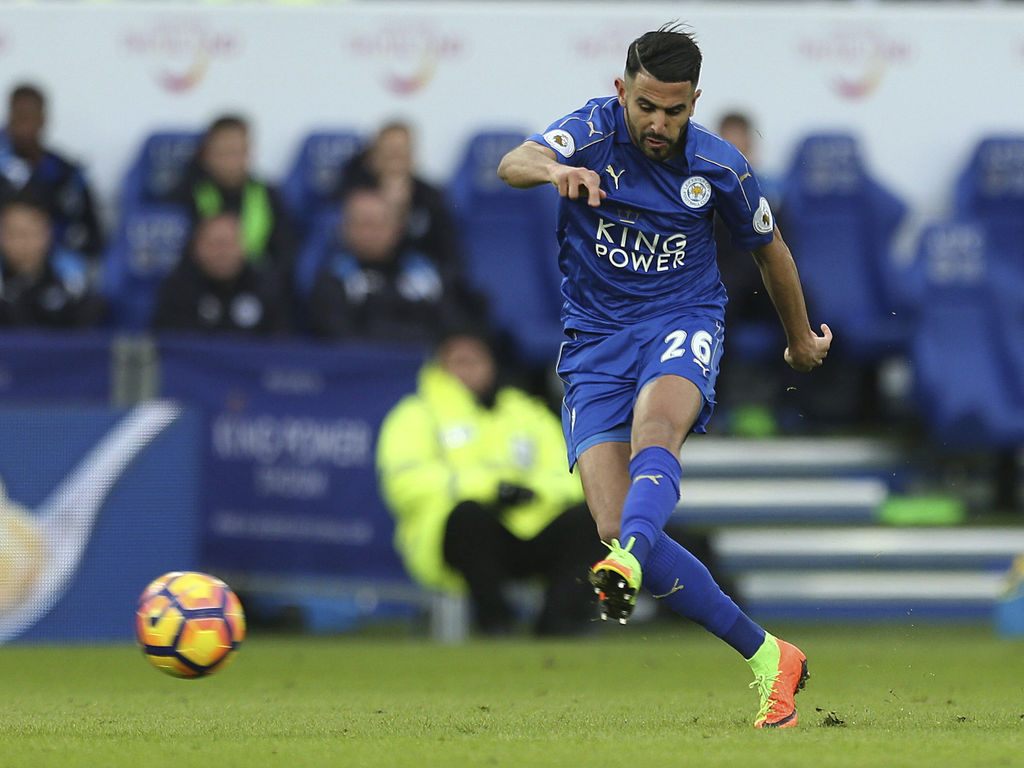 Leicester City's Riyad Mahrez scores his sides second goal during their English Premier League match against Hull City at the King Powe...