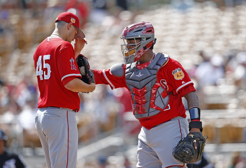 Los Angeles Angels starting pitcher Tyler Skaggs (45) gets a visit from catcher Martin Maldonado, right, during the first inning of a s...