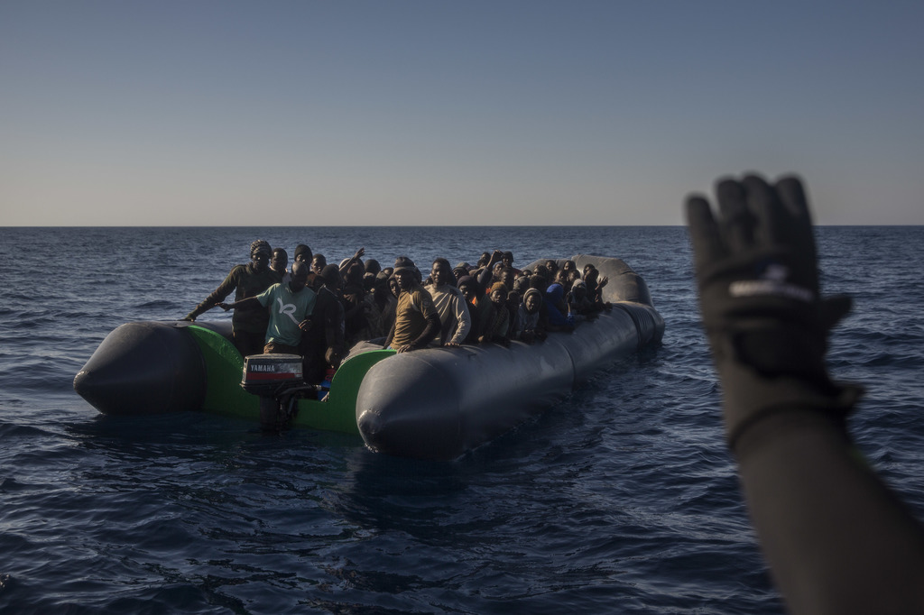 Members of the Spanish NGO Proactiva Open Arms assist refugees and migrants, from different African countries that left Libya aboard 2 ...