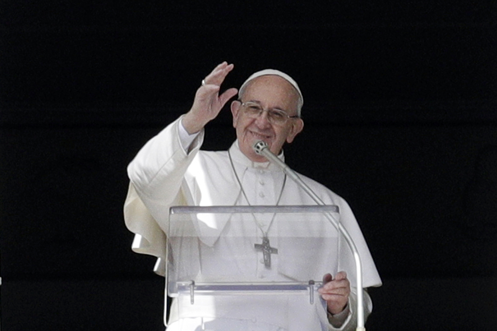 Pope Francis waves to faithful during the Angelus prayer delivered by Pope Francis in St. Peter's Square at the Vatican, Sunday, March ...