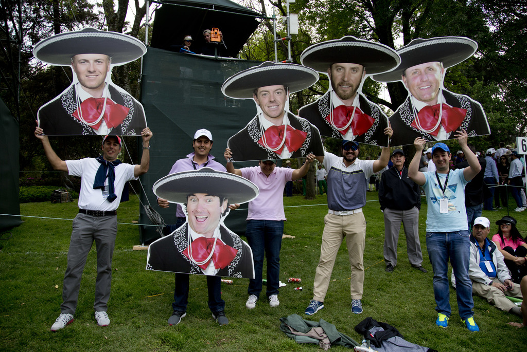 Mexican golf fans hold mariachi motif cutouts depicting from left to right; Jordan Spieth, of the U.S.; Bubba Watson, of the U.S.; Nort...