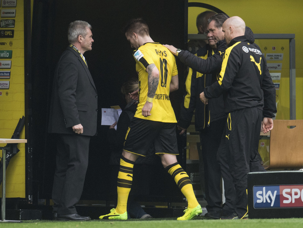(o Reus leaves the field with an injury during the German Bundesliga soccer match between Borussia Dortmund and Bayer Leverkusen in the...