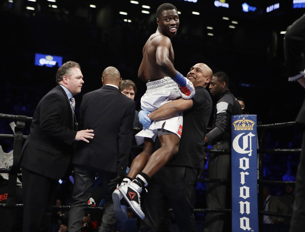 Richardson Hitchins celebrates after a boxing match against Mario Perez, of Mexico, Saturday, March 4, 2017, in New York. Hitchins stop...