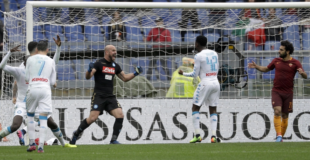 Napoli goalkeeper Pepe Reina, third from right, celebrates after a save during a Serie A soccer match between Roma and Napoli, at the R...