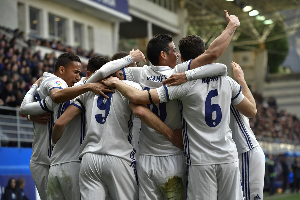 Real Madrid's James Rodriguez, second right, celebrates after scoring his team's third goal of the game during the Spanish La Liga socc...