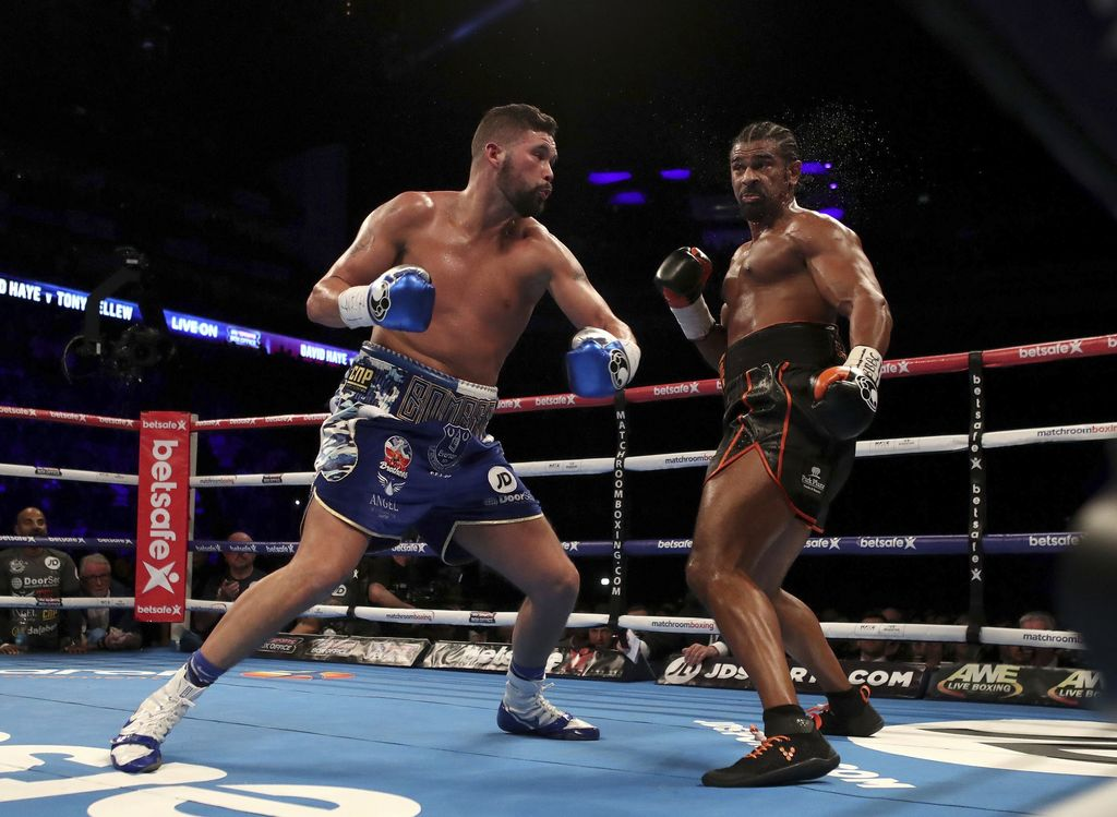 Tony Bellew, left, and David Haye in action during the heavyweight contest in London, Saturday March 4, 2017. (Nick Potts/PA via AP)   ...