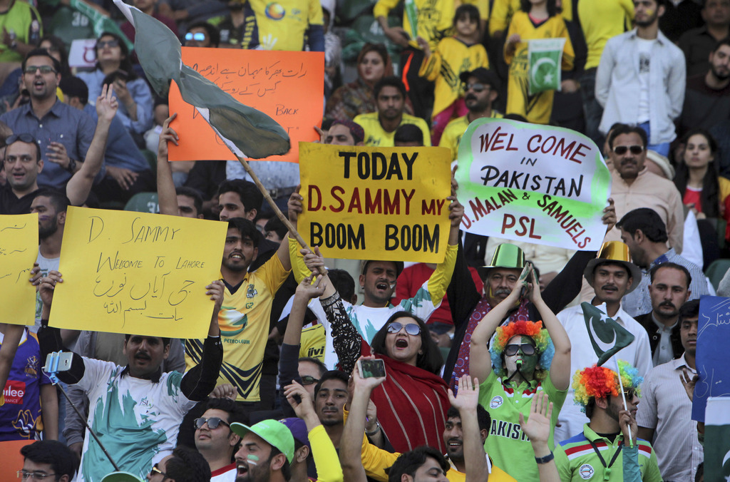 Pakistani cricket fans celebrate the final of Pakistan Sports League at the Gaddafi Stadium, in Lahore, Pakistan, Sunday, March 5, 2017...